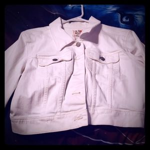 A long sleeve white jean jacket